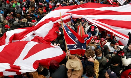 Trump supporters wave American and Confederate flags during clashes with Capitol police on Wednesday.