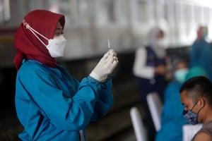 Coronavirus live news: Indonesian doctors ill despite Sinovac shots; Tokyo plans to lift emergency before Olympics | World news