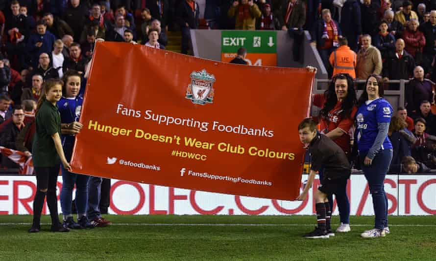 Everton and Liverpool fans hold a banner in support of food banks at half-time in a Merseyside derby at Anfield. The area close to both clubs' stadiums is one of the poorest in Europe.