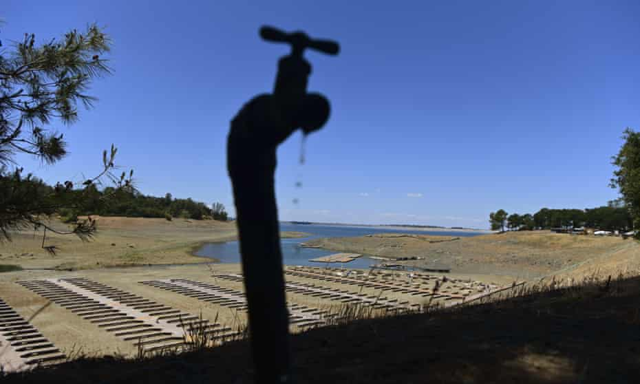 Water drips from a faucet near boat docks sitting on dry land at the drought-stricken Folsom Lake last month.
