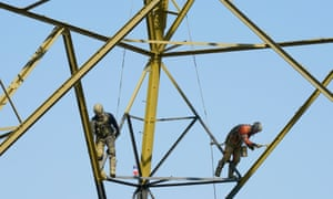Workers on an electricity pylon