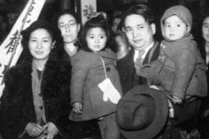 Reverend Kiyoshi Tanimoto and his family at the Hiroshima Station as they see him off during one of his trips to the United States in 1947. His daughter, Koko Kondo, is in the middle.