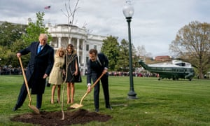 Melania Trump and Brigitte Macron watch as President Donald Trump and French President Emmanuel Macron participate in a tree planting ceremony on the South Lawn of the White House in April 2018.