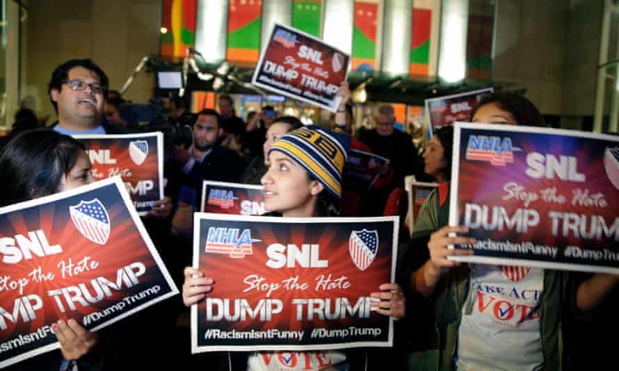 Protesters opposed to the appearance of Donald Trump as host on Saturday Night Live are seen shouting anti-Trump slogans across the street from NBC Studios.