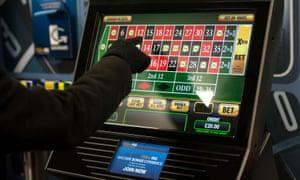 Someone using a gambling machine