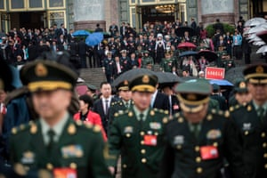 Chinese military delegates leave after the sppech by the Chinese president Xi Jinping
