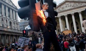 An effigy of a banker is burned during G20 protests in the City of London in 2009