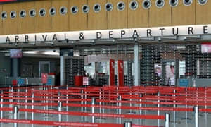 An empty arrivals and departures security point at the Qantas terminal at Sydney Airport