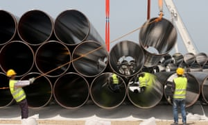 Workers unload pipes in for the Trans Adriatic Pipeline in Albania. The 539-mile pipeline will cross Greece, Albania and under the Adriatic before reaching Italy.