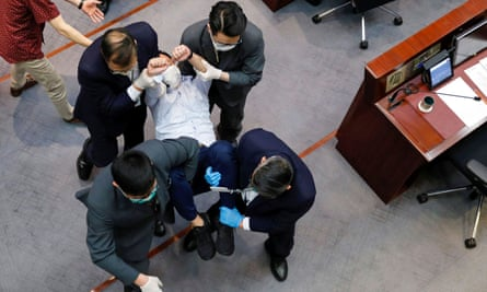 Legislator Raymond Chan Chi-chuen was dragged out of the chamber by security on Friday as he protested against the new security laws.