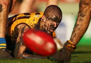 Footballers in mud