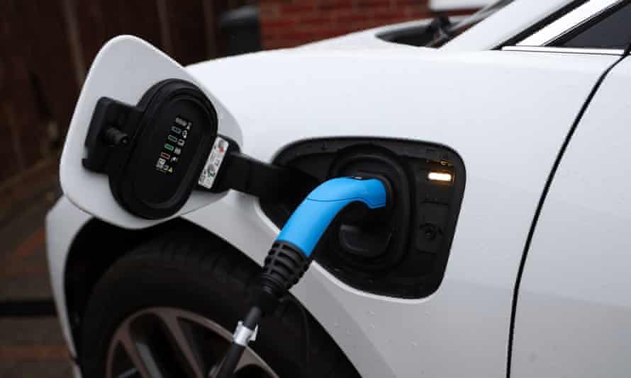 an electric car being charged at home