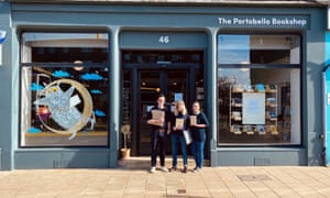 'We've had a big increase in people ordering via our website and over the phone, which has been great.' Staff at The Portobello Bookshop in Edinburgh holding books to be hand-delivered.