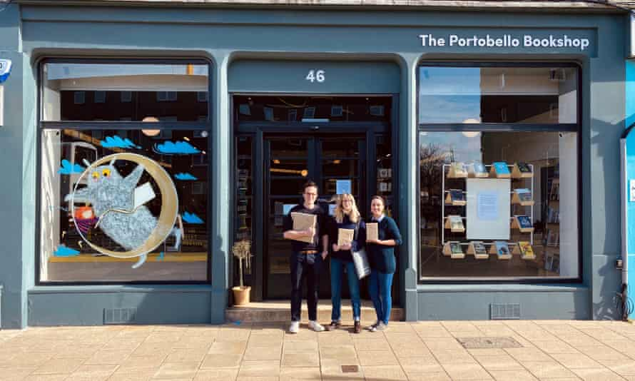 Booksellers of The Portobello Bookshop in Edinburgh, holding books to be hand-delivered in 2020.