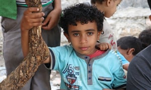 Ahmed Abdu, aged nine. Most of his family are across the frontline and he has been left to care for ageing relatives.