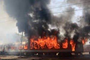 Smoke and flames billow from a train after it caught fire in Gwalior, India