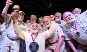 Michael Groover, kneeling, poses with past winners of the Hemingway Look-Alike Contest at Sloppy Joe's Bar in Key West.