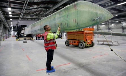 A technician at Siemens' wind turbine plant in Hull; the 75m blade is the largest object cast as a single piece anywhere in the world.