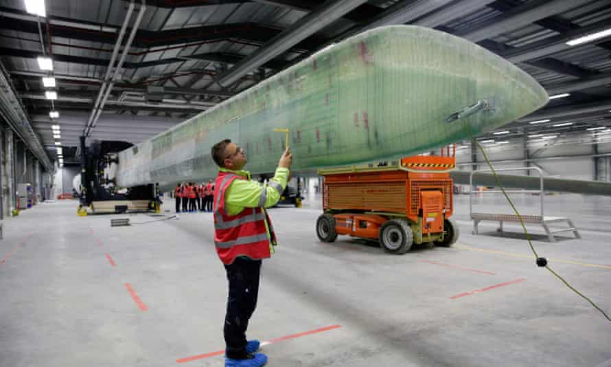 An employee performs quality control checks on a wind turbine blade at the Siemens AG plant in Hull, UK