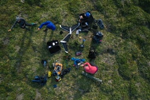 Overhead drone shot of people setting up equipment