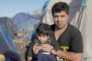 British citizen Rawand Aziz with his son Oscar at the Dunkirk camp.