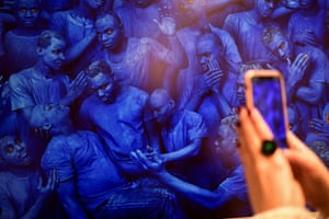 Milan, Italy A visitor photographs an artwork entitled Blue Europe by Chinese artist Liu Bolin, on display at the Mudec museum in Milan