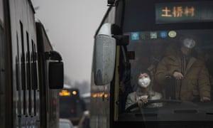 Chinese commuters wear masks
