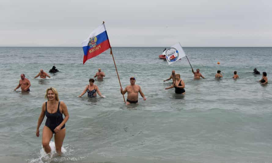 Crimean people wave a Russian national flag celebrating Orthodox Christmas in the Black Sea, 7 January 2016.