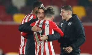 Brentford's Emiliano Marcondes celebrates with manager Thomas Frank.