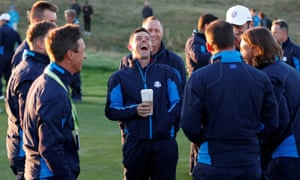 McIlroy shares a joke with the European team as they gathered at Le Golf National on Tuesday.