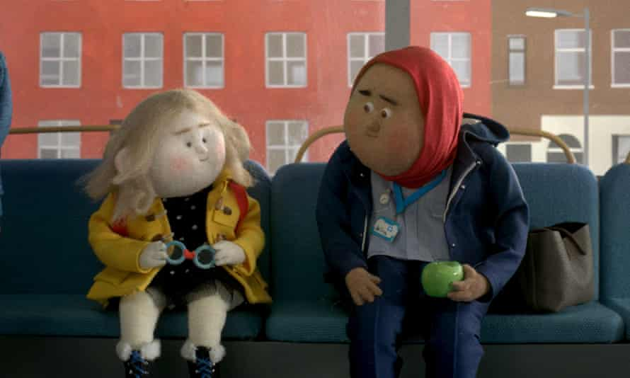 'Simple, beautiful and lovely' ... a girl has her glasses fixed by a stranger in the John Lewis advert.