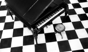 Overview of a grand piano on a checkered floor
