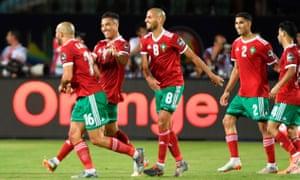 Morocco's En-Nesyri celebrates scoring their opening goal.