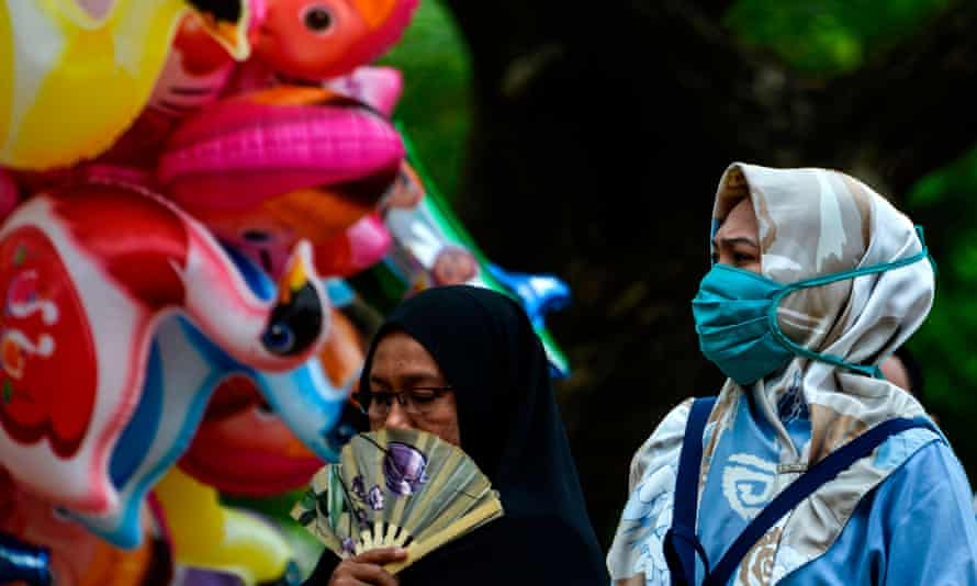 A woman wears a face mask in Banda Aceh