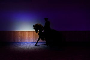 A rider on his horse performing in a public show at the arena Henrique Calado in Lisbon