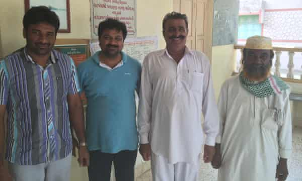 Gajendrasinh Jadeja, the head of the village of Navinal, and Bharat Patel, the head of the local fishermen's union, with two other plaintiffs