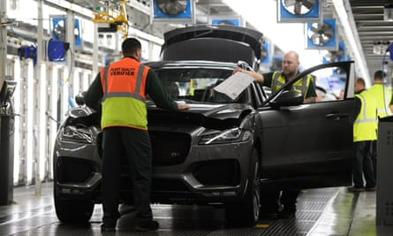 Vehicles are checked before moving to the next stage of production at the Jaguar Land Rover factory