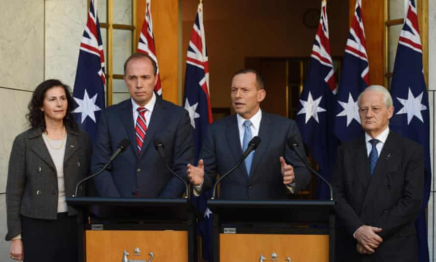 (L-R) Senator Concetta Fierravanti-Wells, Immigration minister Peter Dutton, Prime Minister Tony Abbott and Philip Ruddock speak during a press conference at Parliament House in Canberra, Tuesday, May 26, 2015. (AAP Image/Lukas Coch) NO ARCHIVING