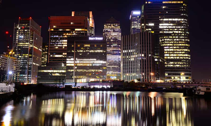 Canary Wharf buildings at night in London.