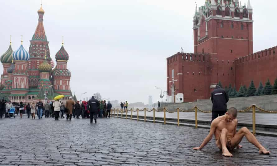 'Living pain' artist Pavlensky sits with his scrotum nailed to the floor of the Red Square in November 2013.