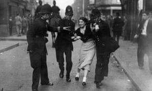 Police arrest a demonstrator during the battle.