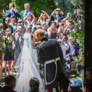 Meghan and Harry kiss after getting married.