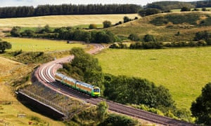 A train travels through countryside between Edinburgh and Galashiels