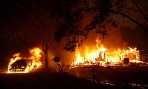 Homes burn after the Kincade fire moved through the area on 24 October 2019 in Geyserville, California.