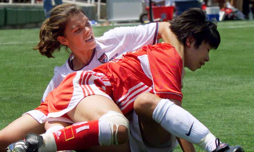 Mia Hamm, our No2 selection, wrestles Chinese defender Bai Jie during the 1999 Women's World Cup final at the Rose Bowl in Pasadena.