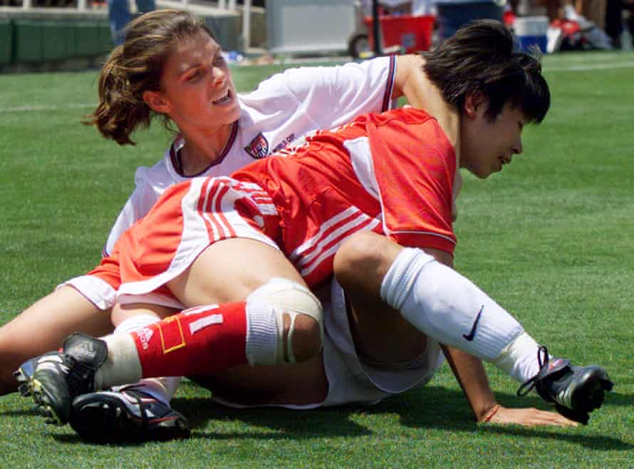 Mia Hamm (left) wrestles with China defender Bai Jie at the 1999 World Cup final.