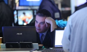 A trader stares at a computer at the New York stock exchange
