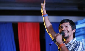 Boxing star Manny Pacquiao addresses supporters as he campaigns for a seat in the Philippine Senate at San Pablo city, Laguna province south of Manila, Philippines.