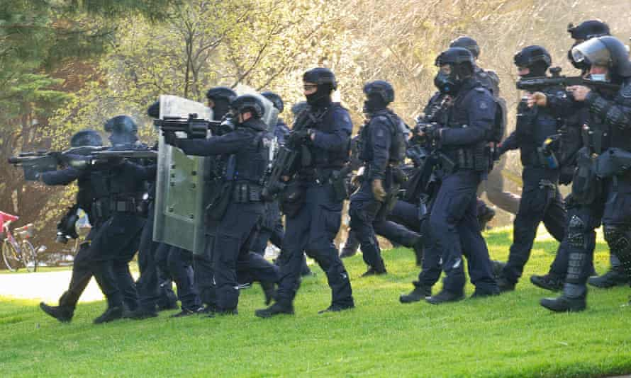 Riot officers clear protesters from the Shrine of Remembrance. Victoria police have been criticised for heave-handed tactics during the protests.