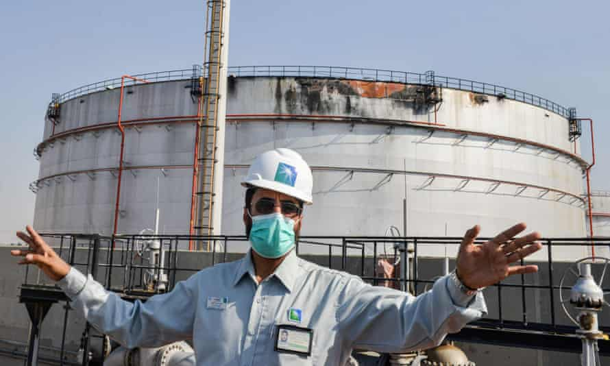An employee of the Aramco oil company in front of a silo in Jeddah damaged in a missile attack in November.